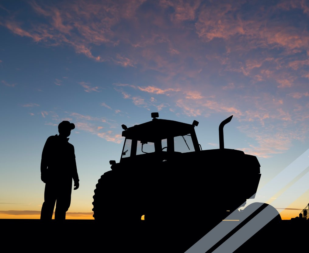 Silhouette of farmer and tractor